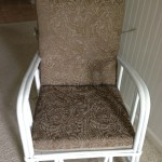 Bamboo chair with tan cushion